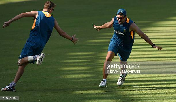 South Africa's Chris Morrisand Rilee Rossouw react after scoring a point in a game of volleyball during a training session of the ongoing World T20...