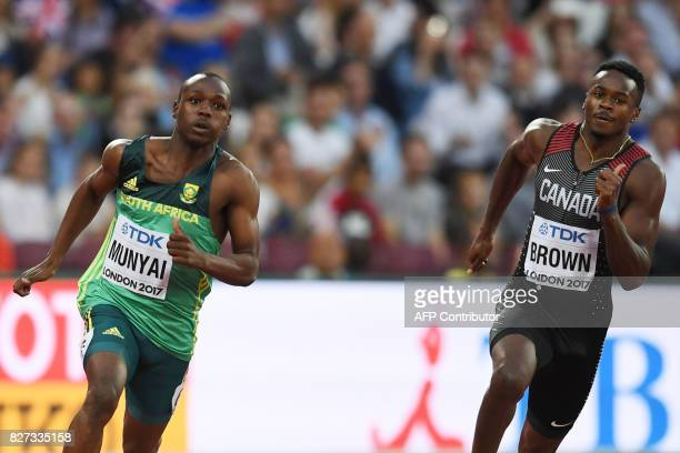 South Africa's Clarence Munyai and Canada's Aaron Brown compete in the heats of the men's 200m athletics event at the 2017 IAAF World Championships...