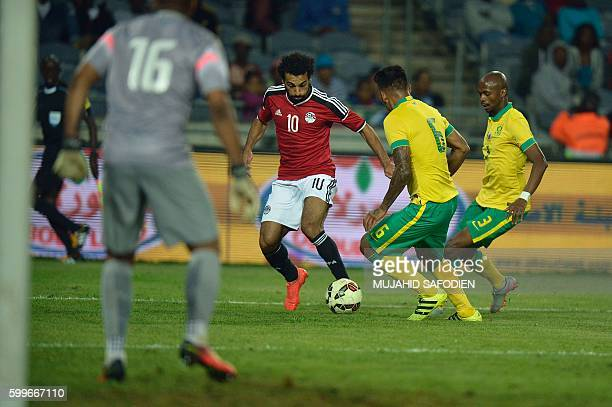 South Africa's Clayton Micheal Daniels vies with Egyp's Mohamed Salah during the friendly football match South Africa vs Egypt at Orlando Stadium on...