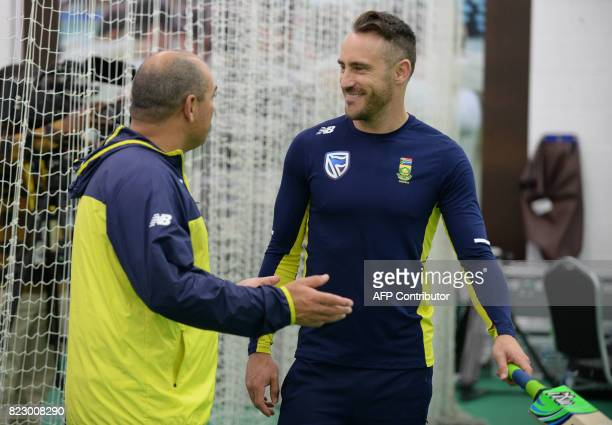 south Africa's coach Russell Domingo and South Africa's captain Faf du Plessis interact during the south African cricket team's training session at...