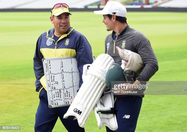 South Africa's coach Russell Domingo arrives with South Africa's Quinton de Kock for a nets practice session at Old Trafford cricket ground in...