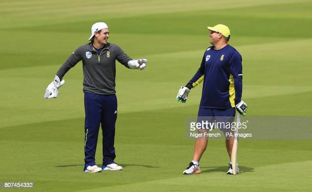 South Africa's coach Russell Domingo shares a joke with wicket keeper Quinton de Kock during the nets session at Lord's London