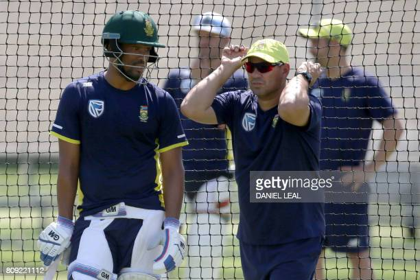 South Africa's coach Russell Domingo watches during a practice session prior to the first Test match between England and South Africa at Lord's...