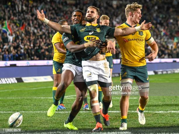 South Africa's Cobus Reinach celebrates after scoring a try during the 2019 Rugby Championship match South Africa v Australia at the Emirates Airline...