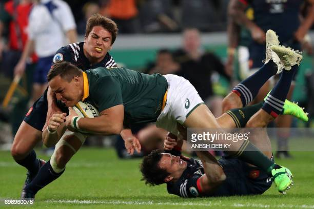 South Africa's Coenie Oosthuizen is tackled by France's Antoine Dupont as he scores a try during the International test match between South Africa...