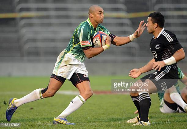 South Africa's Cornal Hendricks carries the ball past New Zealand's Sherwin Stowers during their rugby union Tokyo Sevens 2013 final in Tokyo on...