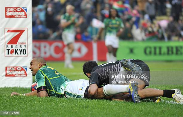 South Africa's Cornal Hendricks scores a try against New Zealand during their rugby union Tokyo Sevens 2013 final in Tokyo on March 31 2013 South...