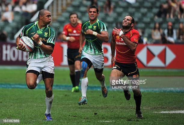 South Africa's Cornal Hendricks sprints to score a try against Spain during the Hong Kong Rugby Sevens tournament on March 24 2013 AFP PHOTO /...