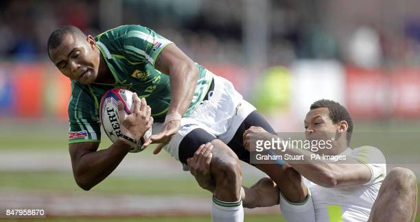 South Africa's Cornal Hendricks tackled by England's Dan Norton during a Cup quarterfinal during the Glasgow Sevens at Scotstoun Stadium Glasgow