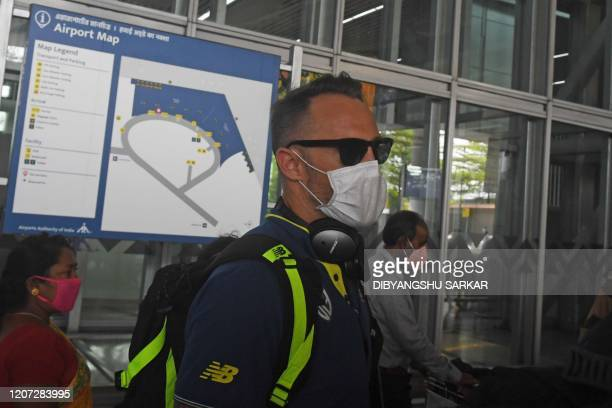 South Africa's cricket player Faf du Plessis wearing a facemask amid concerns over the spread of the COVID19 novel coronavirus arrives at the airport...