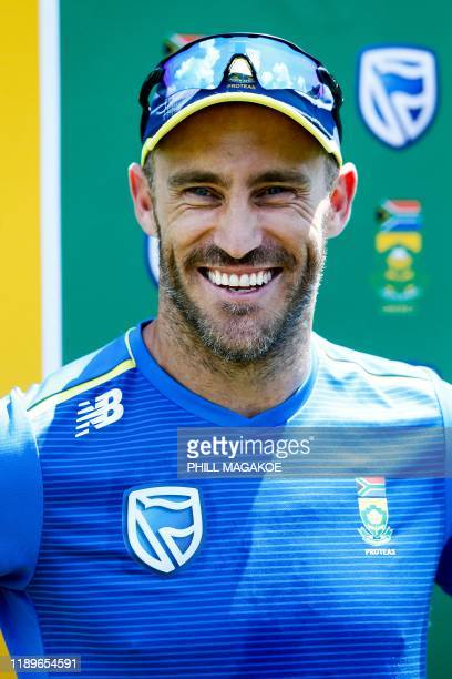 South Africa's cricket team captain Faf Du Plessis speaks to the press following a team training session at the Supersport Park Cricket Stadium in...