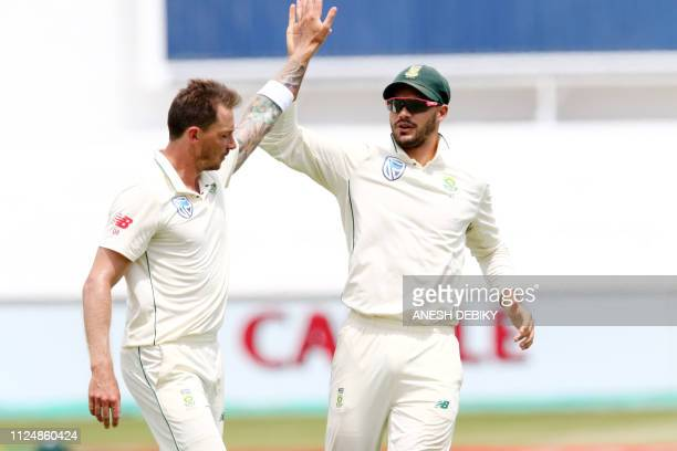 South Africa's Dale Steyn and Aiden Markram celebrate the wicket of Sri Lanka's Kusal Perera during day 2 of the first test match between South...