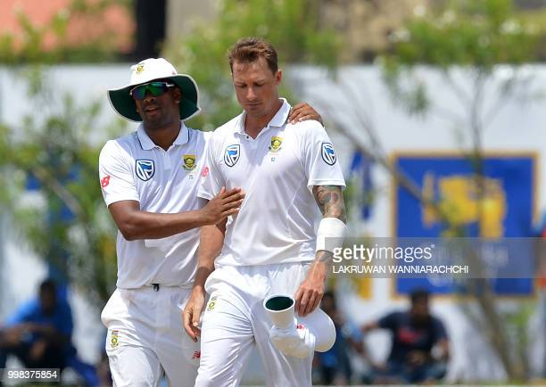 South Africa's Dale Steyn is congratulated by his teammate Vernon Philander after dismissing Sri Lanka's Lakshan Sandakan during the third day of the...