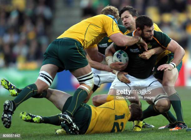 South Africa's Danie Rossouw is tackled by Australia's David Pocock Pat McCabe and Adam AshleyCooper during the 2011 Rugby World Cup Quarter Final...