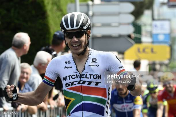 South Africa's Daryl Impey celebrates after he crossed the finish line to win the first stage ahead of France's Julian Alaphilippe of the 70th...