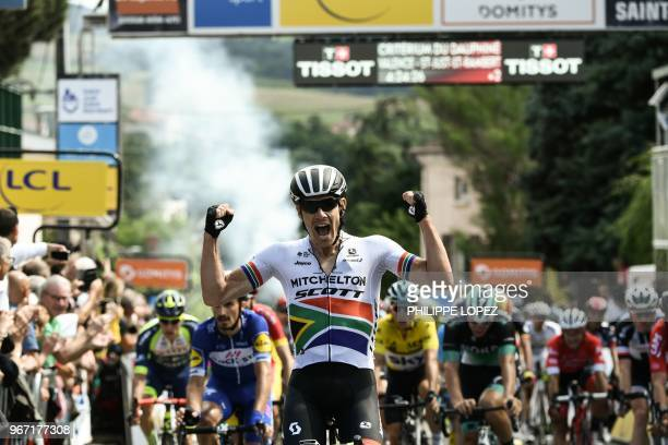 TOPSHOT South Africa's Daryl Impey celebrates as he crosses the finish line to win the first stage of the 70th edition of the Criterium du Dauphine...