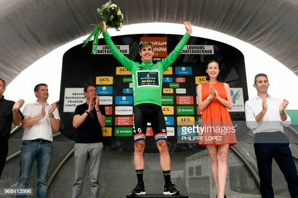 South Africa's Daryl Impey, wearing the best sprinter's green jersey, celebrates on the podium after the third stage of the 70th edition of the...