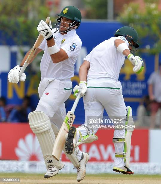 South Africa's Dean Elgar and Aiden Markram run between the wickets during the third day of the opening Test match between Sri Lanka and South Africa...