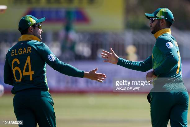 South Africa's Dean Elgar and South Africa's Aiden Markram celebrate after dismissing Zimbabwe's Solomon Mire during the first One Day International...
