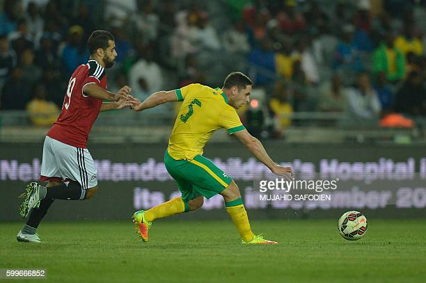 South Africa's Dean Furman vies with Egypt's Mahmoud Hassan Amr Gamal during the friendly football match South Africa vs Egypt at Orlando Stadium on...