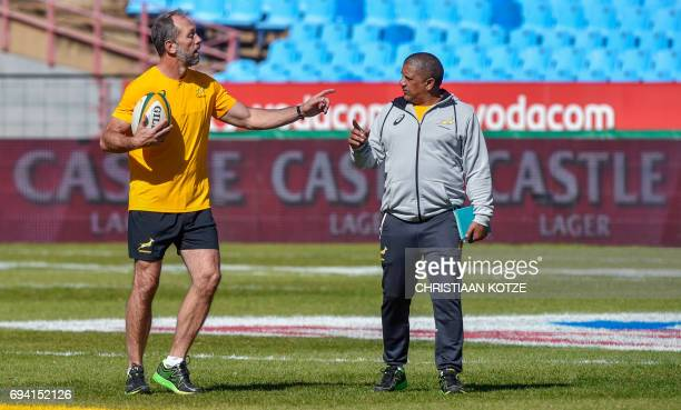 South Africa's defence coach Brendan Venter and head Coach Allister Coetzee talk during a training session at St David's Marist School at Loftus...