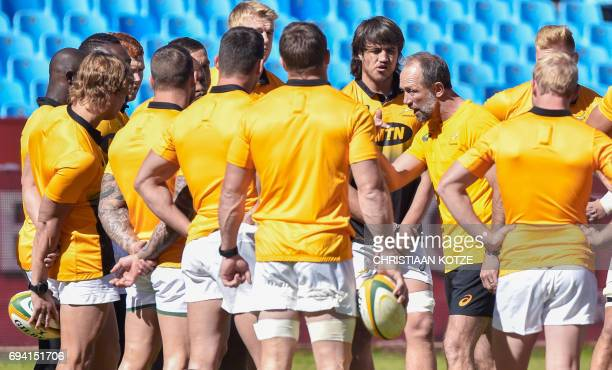 South Africa's defence coach Brendan Venter talk to players during a training session at St David's Marist School at Loftus rugby stadium on June 9...