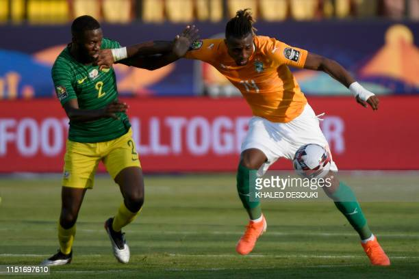 South Africa's defender Buhle Mkhwanazi fights for the ball with Ivory Coast's forward Jonathan Kodjia during the 2019 Africa Cup of Nations football...