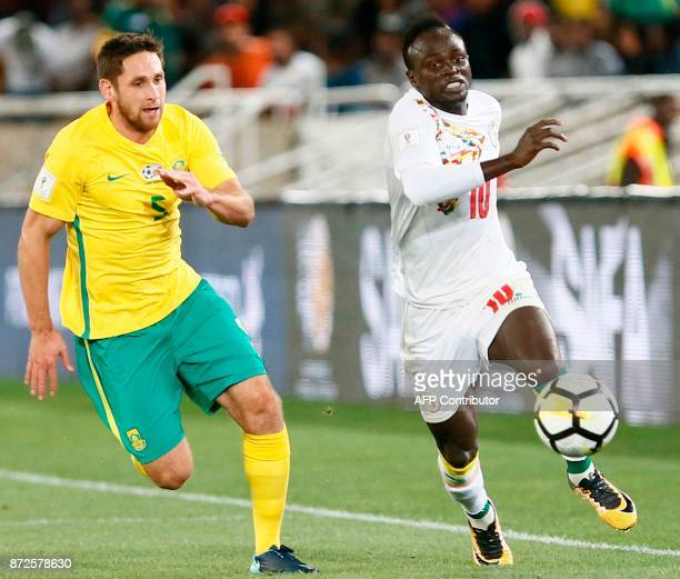 South Africa's defender Dean Furman fights for the ball with Senegal's midfielder Sadio Mane during the FIFA 2018 World Cup Africa Group D qualifying...