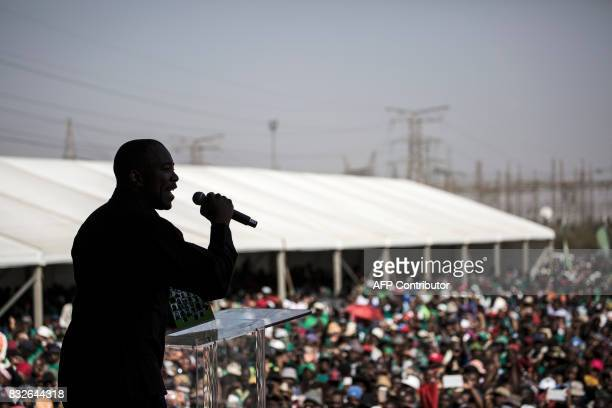 South Africa's Democratic Alliance opposition party leader Mmusi Maimane addresses the crowd as members of the Association of Mineworkers and the...