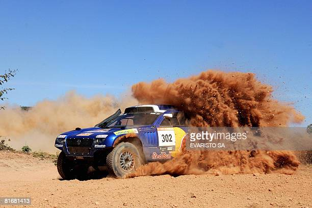 South Africa's driver Giniel de Villiers with codriver Dirk von Zitzewitz races his Volkswagen Race Touareg during the 6th stage of the Rally of...
