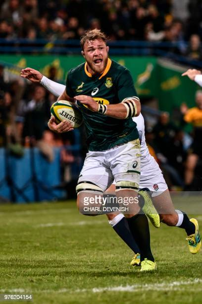 South Africas Duane Vermeulen runs on his way to score a try during the second test match South Africa vs England at the Free State Stadium in...
