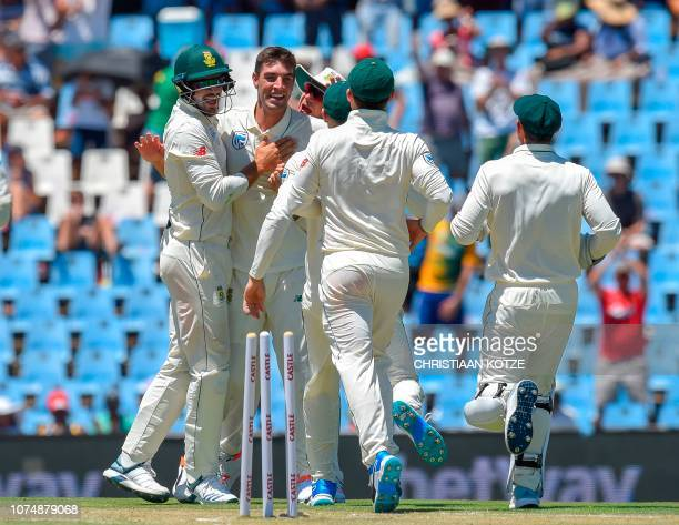 South Africa's Duanne Olivier celebrate after getting Pakistan's Sarfraz Ahmed's wicket during day one of the 1st cricket test match between South...
