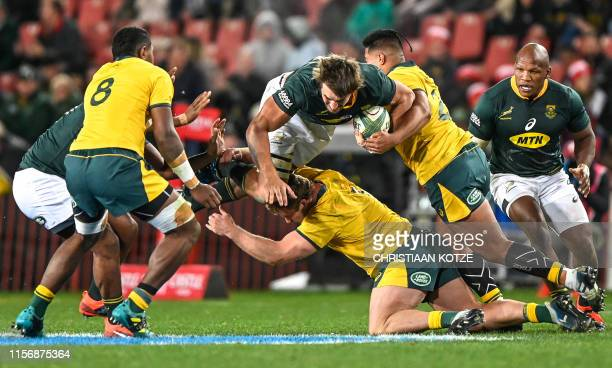 South Africas' Eben Etzebeth is tackled during the 2019 Rugby Championship match South Africa v Australia, at the Emirates Airline Park in...