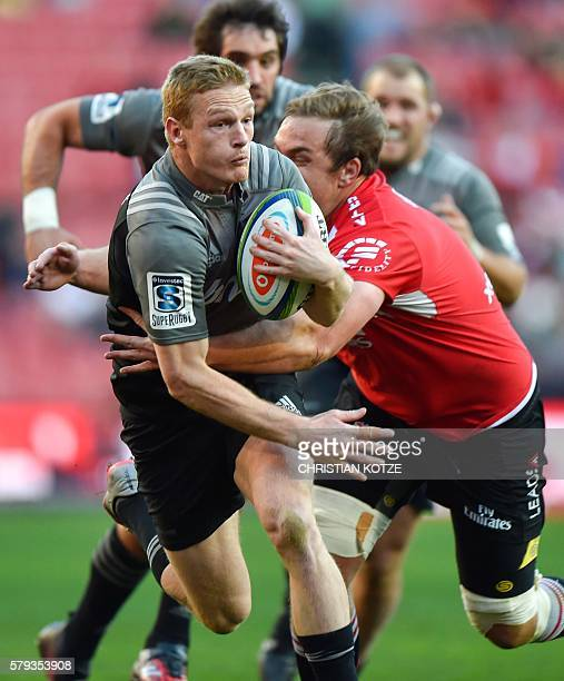 South Africa's Emirates Lions' Andries Ferreira tackles New Zealand's Crusaders' Johnny McNicholl during the Rugby Super 18 quarterfinal clash...