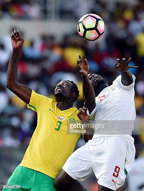 South Africa's Erick Mathoho vies for the ball with Senegal's Mame Diouf during the 2018 World Cup qualifying football match between South Africa and...