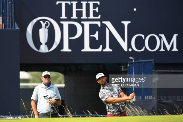 South Africa's Erik Van Rooyen chips onto the 18th green during a practice round for The 149th British Open Golf Championship at Royal St George's,...
