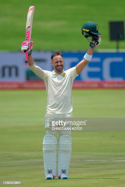 South Africa's Faf du Plessis celebrates after scoring a century during the third day of the first Test cricket match between South Africa and Sri...
