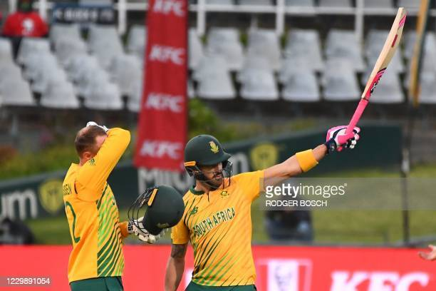South Africa's Faf du Plessis celebrates after scoring a half-century during the third T20 international cricket match between South Africa and...