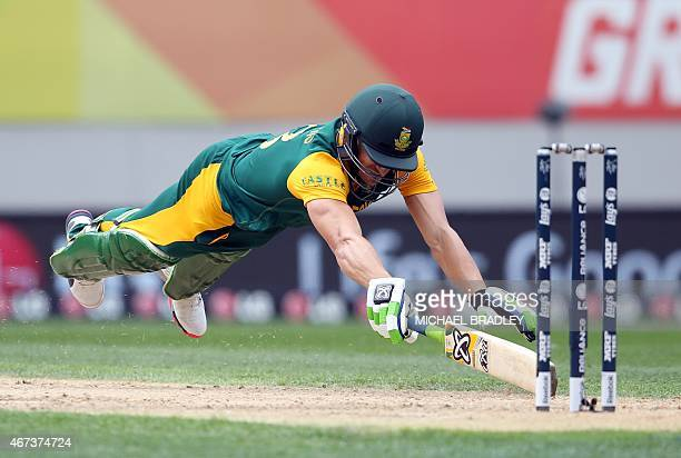 South Africa's Faf du Plessis dives in for a run during the semifinals Cricket World Cup match between New Zealand and South Africa played at Eden...