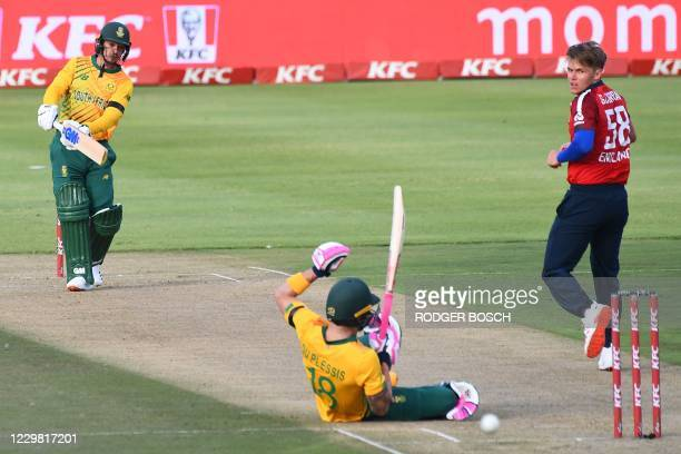 South Africa's Faf du Plessis falls to the ground while ducking for a ball played by South Africa's captain Quinton de Kock from a ball delivered by...