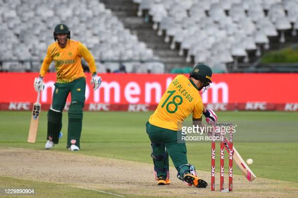 South Africa's Faf du Plessis hits a four during the third T20 international cricket match between South Africa and England at Newlands stadium in...