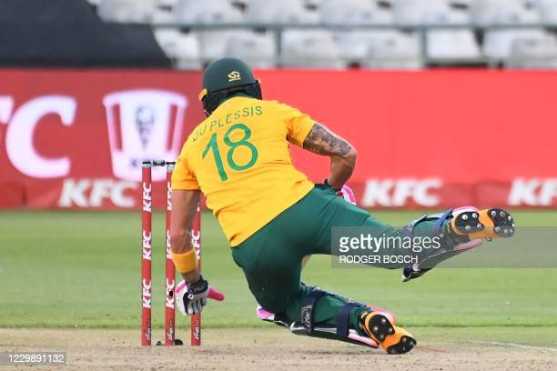 South Africa's Faf du Plessis slips as he tries to get back into the crease during the third T20 international cricket match between South Africa and...