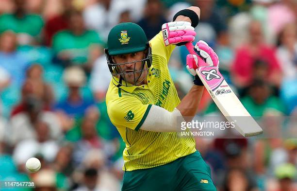 South Africa's Faf du Plessis watches the ball after playing a shot during the 2019 Cricket World Cup group stage match between South Africa and...