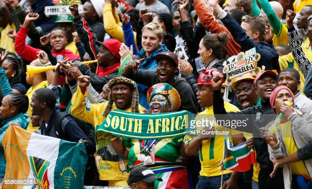 South Africa's fans celebrate their team's win during the Fifa World Cup 2018 qualifying football match South Africa vs Burkina Faso at Soccer City...