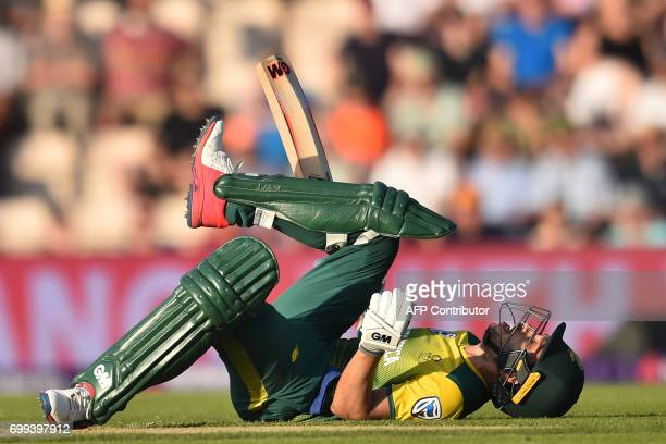 South Africa's Farhaan Behardien is felled by a ball from England's David Willey during the T20 international cricket match between England and South...