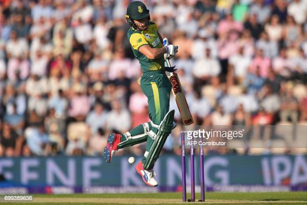 South Africa's Farhaan Behardien is hit by a short ball from England's Mark Wood during the T20 international cricket match between England and South...