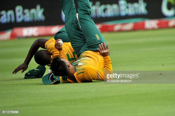 South Africa's fielders Kagiso Rabada and JP Duminy collide as Duminy catches a shot by England's Alex Hales during the first Twenty20 international...