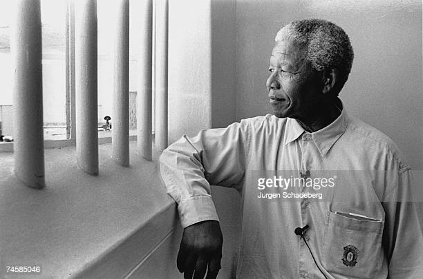 South Africa's first black President Nelson Mandela revisits his prison cell on Robben Island where he spent eighteen of his twentyseven years in...