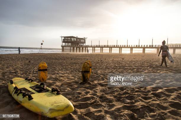 South Africa's first female Zulu professional surfer Samukeliswe Cele is pictured on her way to a practice session at Durban's Ushaka beach on...