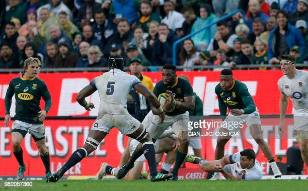 South Africa's flanker and captain Siya Kolisi attempts to avoid a tackle from England's lock Maro Itoje during the rugby union Test match between...